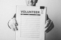 A man signing up to be a volunteer