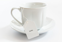 tea cup with the word love on the tea bag