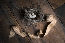 stones in a bird's nest and ribbon