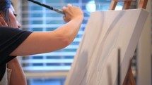an artist painting on canvas