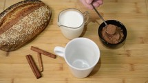 Cooking cocoa from the ingredients laid out on the table