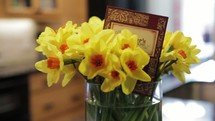 daffodils in a vase and a mother's day card