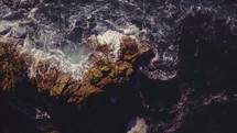 rocks in a churning sea