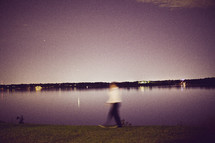 bokeh walking in front of a lake