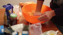 mixing ingredients in a kitchen