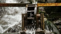 water flowing through a water wheel