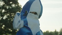 dancing in a shark costume