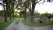 a man visiting a cemetery