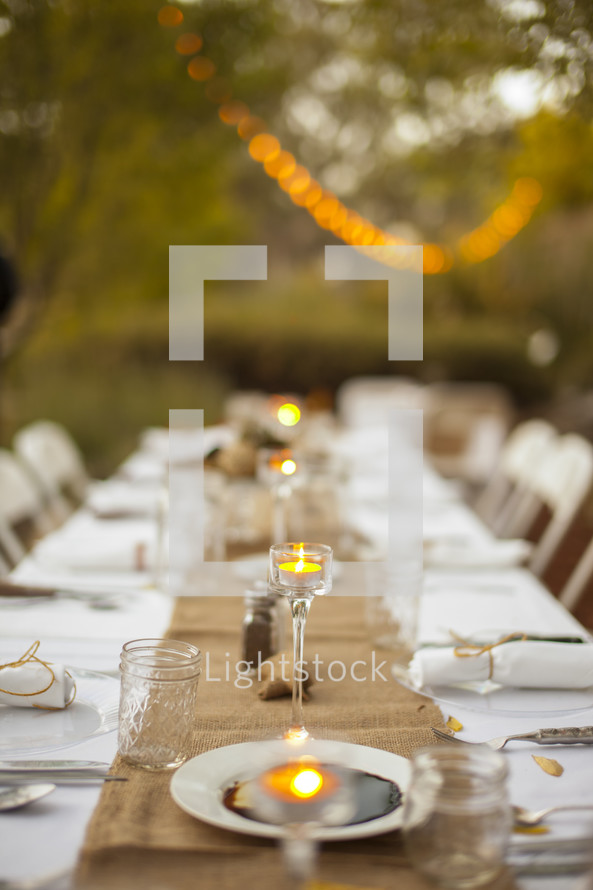Dinner table set with candles