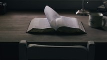 pages turning on a Bible on a desk