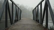 dock over a foggy lake