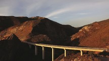 Aerial view over a mountain bridge | Pacific Coast Highway | Road | Coast | California | Traveling | Journey | Sunset | Light | Day