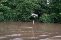one way sign in a flood