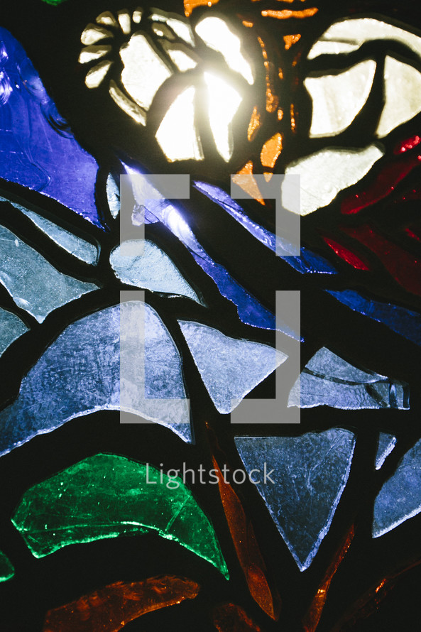 glow of sunlight though stained glass window