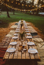 a table set for an outdoor dinner party