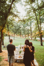 friends gathering for an outdoors dinner party