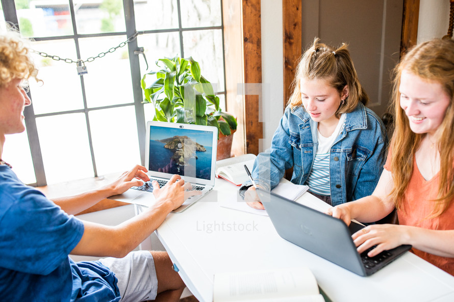 teen boy and girl on a computer for virtual learning