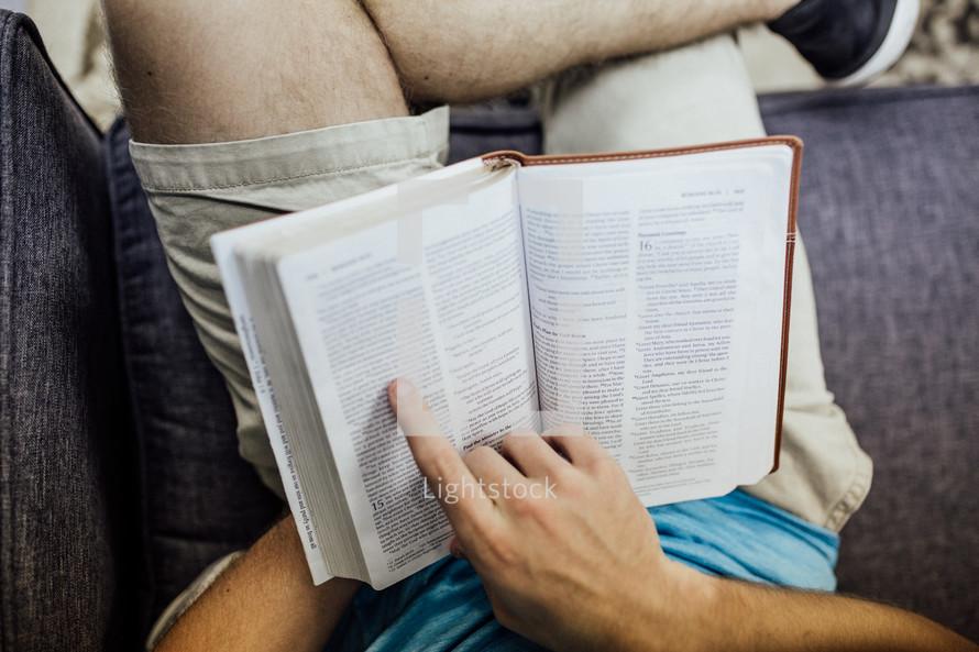 a man reading a Bible at a Bible study