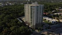 Aerial 4k View of a tall high rise Building near the beach in Florida