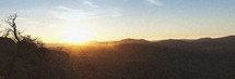 panorama of sunset over rolling hills