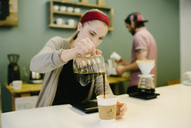 a woman pouring coffee