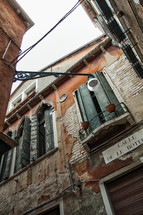 shutters on windows of old buildings in Venice