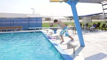 a boy child diving into a swimming pool