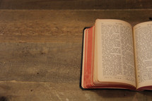 open Bible on a table  - book of John