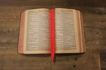 bookmark between the pages of a Bible