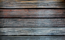 Traffic and weather worn wooden boards