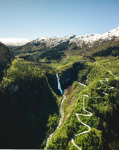 snow capped mountains and waterfall