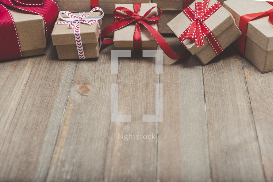 Christmas gifts on a wood background