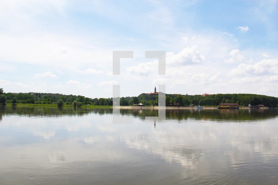 distant steeple across a lake