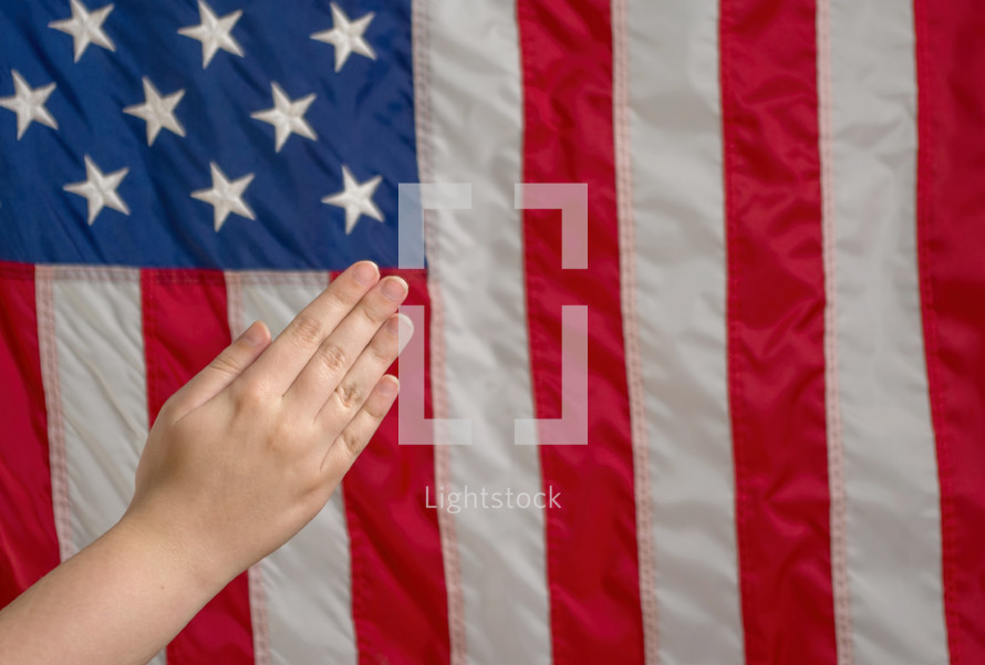 praying hands and American flag