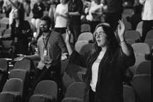 raised hands in an auditorium