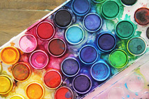 art supplies on a wood background