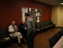 elderly men greeting each other
