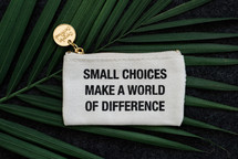 small choices make a world of difference coin purse on a palm frond