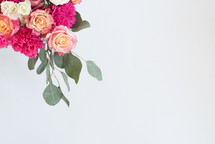 A bouquet of pink and white flowers on a white background.