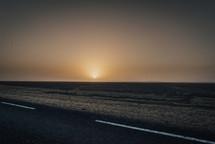 sunset on a black sand beach