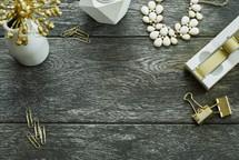 paperclips, tape dispenser, desk, vase, gold, necklace, candle