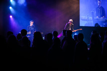 musicians on stage at a youth rally