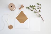 ribbon, envelope, gift tag, stamp, blank card, ribbon, eucalyptus twig