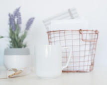 coffee mug, wire basket, and lavender house plant