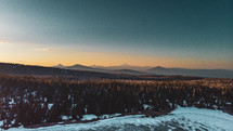 mountains range and snow at sunrise