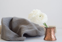 flowers in a vase and linen fabric