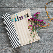 bag of colored pencils and wildflowers