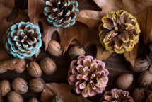 painted pine cones, fall leaves, and acorns