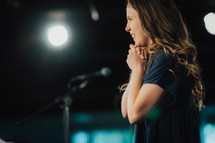 a worship leader praying