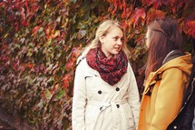 teen girls talking outdoors on a fall day